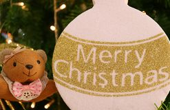 Closed up Little Teddy Bear with Gold and White Merry Christmas Ornament Stock Image