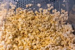 A closed up look through glass cabinet of salted butter popcorn stock images