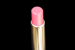 Closed-up lux lipstick isolated on. Closed-up pink lux lipstick  isolated on black Royalty Free Stock Photo