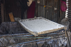 Closed up the mulberry pulp sieve in paper factory, Nepal Stock Photography
