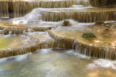 Closed up natural topical stream waterfalls in deep forest national park. Beautiful topical blue stream waterfalls in deep forest national park of Thailand Stock Photography