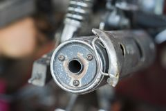 Closed up old aged motorcycle exhaust pipe.  Royalty Free Stock Images