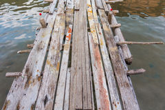 closed up old wood foot path way on water, background and textur Stock Photography