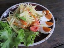 Closed up papaya salad with salted egg Stock Photo