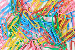 Closed-up paper clips background Stock Photos