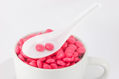 Closed-up pink color pills in cup Stock Photography