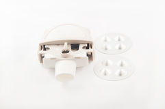 Closed up powder asthma inhaler and capsule in aluminum blister Stock Photo