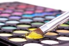 Closed-up professional make-up brush on yellow mak Stock Photography