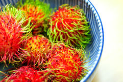 Closed up Rambutan in bowl. Stock Image