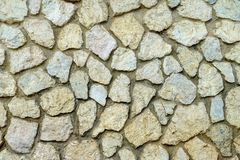 Rock wall or stone wall Stock Images
