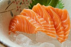 Closed up salmon sashimi, Famous japanese dish. Eating fresh fish. Closed-up raw salmon fish, a top famous Japanese food. The taste is unbelievable yummy for Stock Images