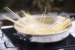 Closed up spaghetti boiling in the pan Royalty Free Stock Images