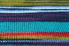 Closed Up Texture of Colorful Striped Alpaca Knitted Wool Fabric in Horizontal Patterns. Abstract background blanket blue cloth craft fashion fiber focus frame stock photos