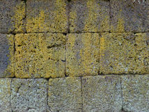 Closed up texture of rough ancient stone wall at Phanom Rung Historical Park Royalty Free Stock Photos