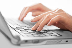 Closed up of typing female hands, selective focus Royalty Free Stock Photos