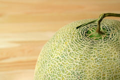 Closed up unique pattern of Cantaloupe Melon`s peel with stem, blurred background and free space for design Stock Photo