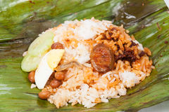 Closed up of the unwrapped original nasi lemak on banana leaf. Royalty Free Stock Photo