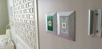 Closed up vacuum outlet on white wall by green oxygen outlet in patient room. Royalty Free Stock Photos