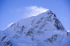 Closed up view of Lhotse peak with snow blowing on top from Gorak Shep. During the way to Everest base camp. Stock Photo