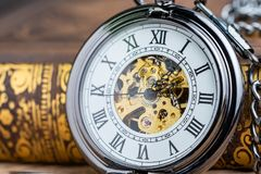 Closed Up Vintage Pocket Watch On Book Using As Time Symbol Or B Stock Photo