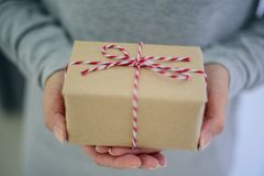 Closed up of woman hands with gift box.  Royalty Free Stock Images
