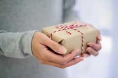 Closed up of woman hands with gift box.  Stock Photos