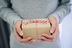 Closed up of woman hands with gift box.  Royalty Free Stock Photography