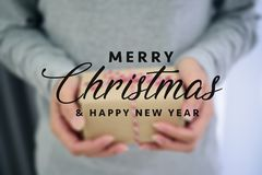 Closed up of woman hands with gift box.  Royalty Free Stock Image
