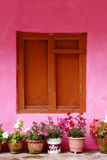 Closed up the wood windows with pink wall, in village Nepal Stock Photo