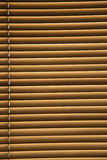 Closed Venetian Blinds. Back lit by the sun Stock Images