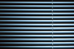 Closed Venetian Blinds Under Night Light Stock Image
