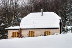Closed village house over the snow. Winter day Royalty Free Stock Image