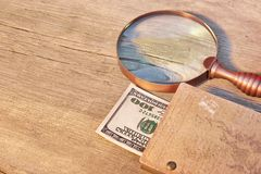 Closed Vintage Notepad with  Hundred Dollar Bill, magnifying gla Royalty Free Stock Photo