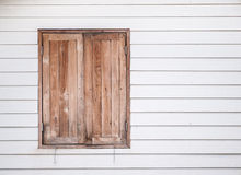 Closed vintage wooden window on white wall Stock Photo