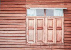 Closed vintage wooden window on wooden wall Royalty Free Stock Photography