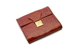 Closed wallet. A closed brown wallet on white background Royalty Free Stock Photography