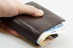 Closed wallet. Full of banknotes Stock Photo