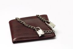 Closed wallet tied with chain. On white background Stock Image