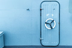 Closed watertight door in a ship. The door provides a functional barrier between watertight bulkheads Stock Image