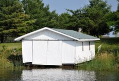 Closed white boat house. Closed white wooden boat house Stock Image