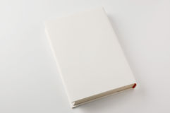 Closed white cover book on white background Royalty Free Stock Photography