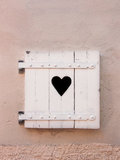 Closed white old shutters with heart shape (11). The white old shutters with heart shape are closed Stock Photography