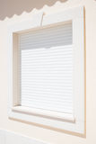 Closed white plastic modern shutter on a window Stock Image