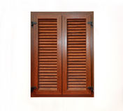 Closed window. With brown wooden blinds from outside Royalty Free Stock Image