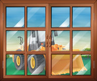 A closed window with a bulldozer Stock Photography