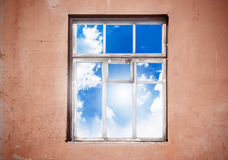 Closed window with clouds Stock Photo