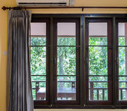 Closed window with curtain Royalty Free Stock Photography