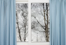 Closed window with curtains  autumn weather Royalty Free Stock Image