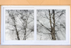 Closed window with curtains autumn weather Royalty Free Stock Photos