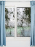 Closed window with curtains in rainy autumn Stock Photography
